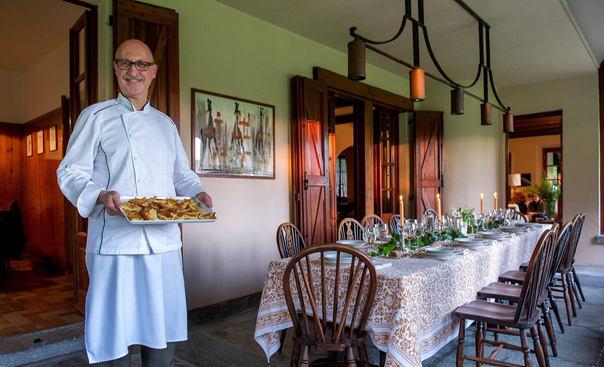 Marco Personal Chef serving Farinata in a villa